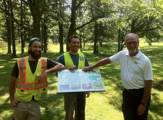 WPC's Eric Jolin and Mike Bagnall (left to right) present LaSalle Mayor Ken Antaya with new interpretive sign at LaSalle Woods.